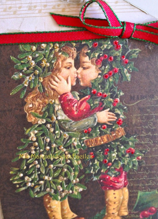 Beso niños Acebo Navidad
